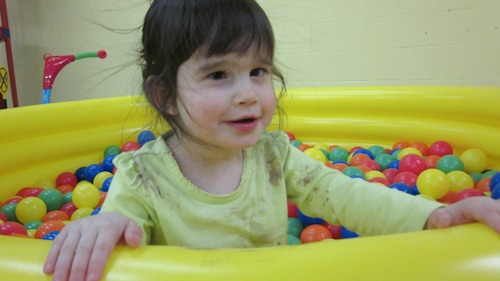 Playing in the ball pit at her Social Group.